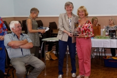 Ivy Evans presenting Ethestone Trophy to June Morris