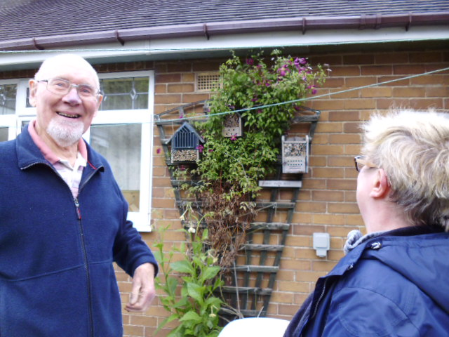 Bill enjoying showing a visitor his colony of red mason bees
