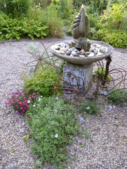 Attractive planting by the water feature